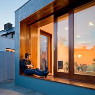 Recessed window creates bench between lounge and garden in Dublin house extension