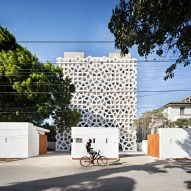 White latticed screens encase apartment block in Kenya by Urko Sanchez Architects