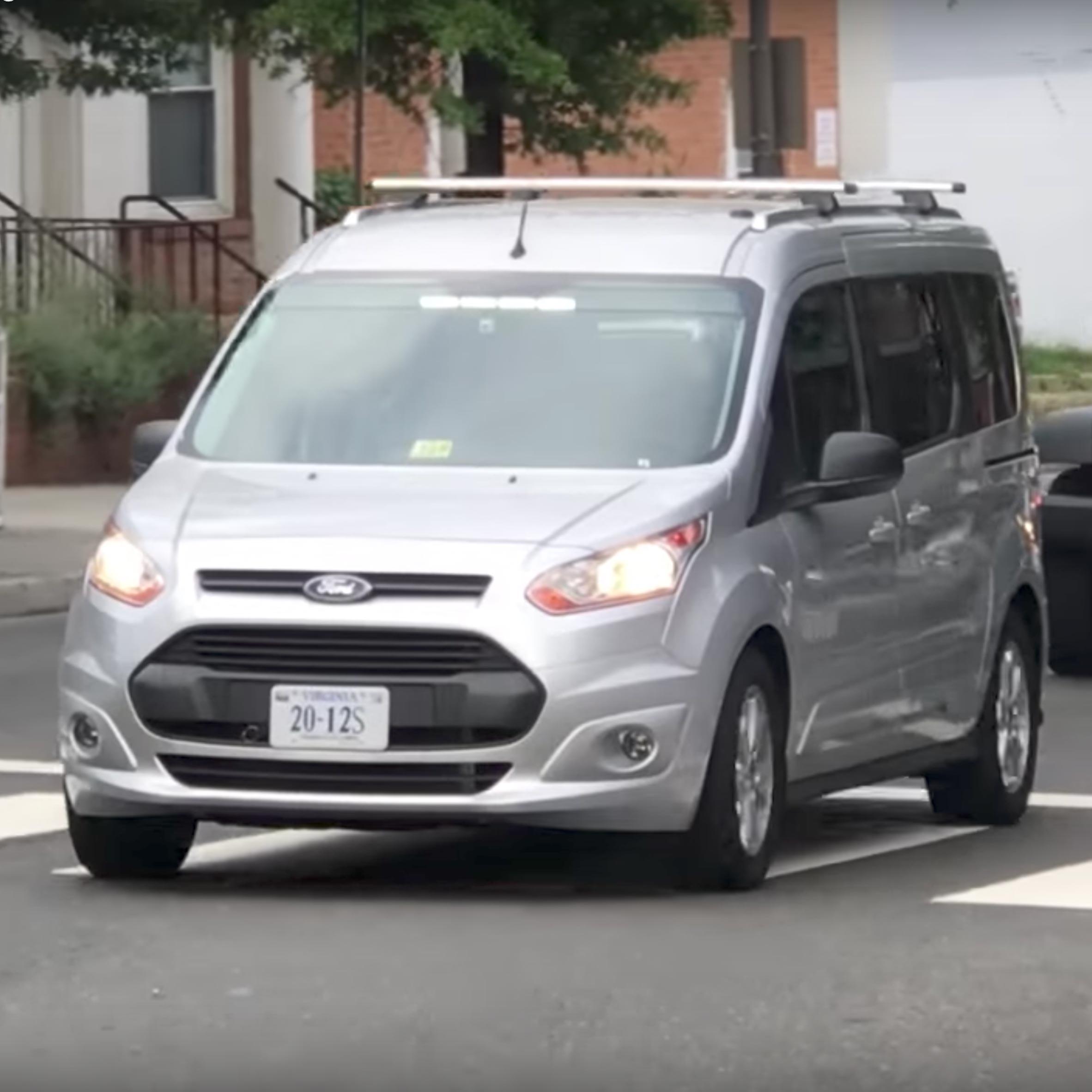 virginia techs driverless van is steered by a man dressed as a car seat