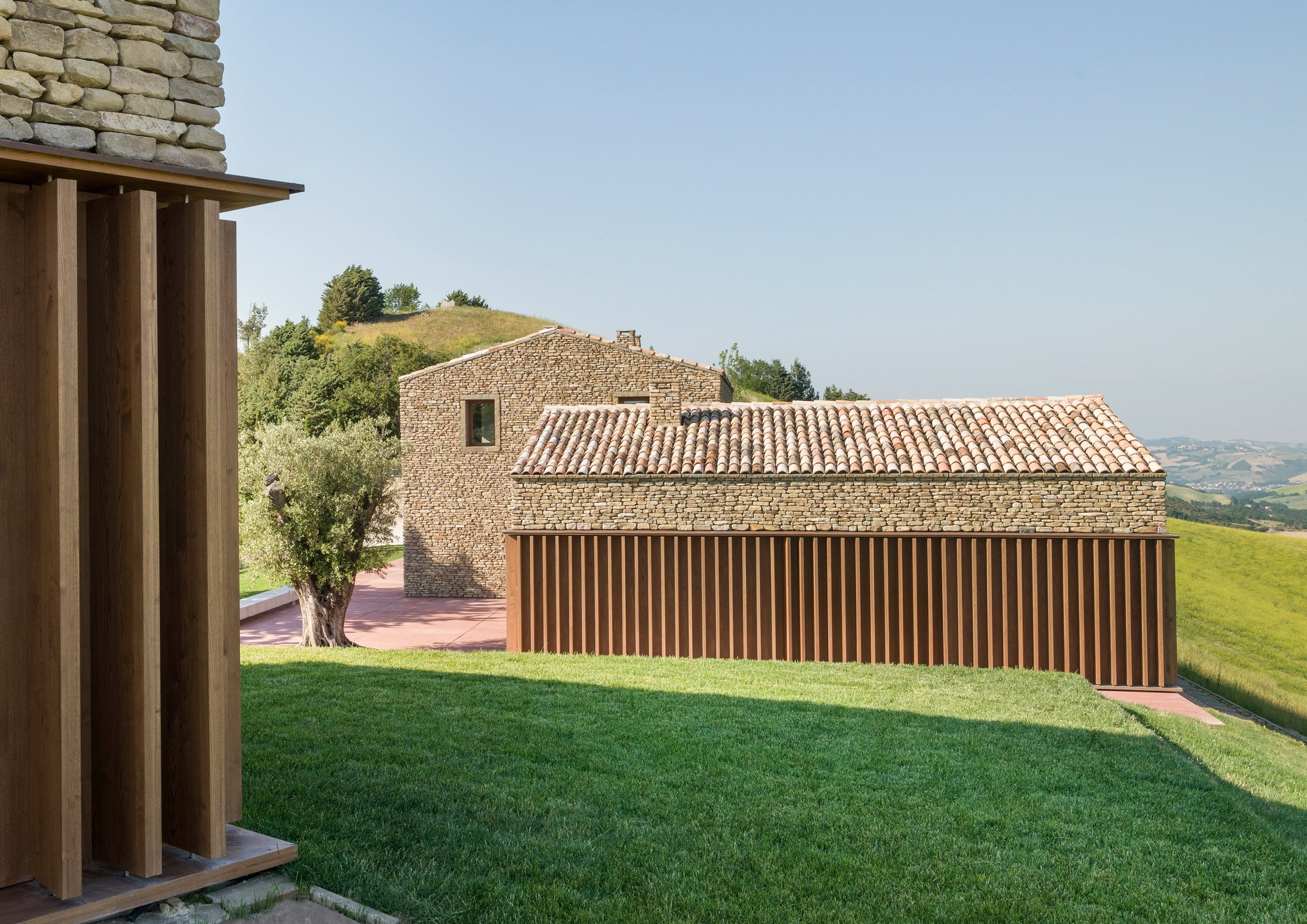 Rural Italian residence combines traditional stone exterior with contemporary details