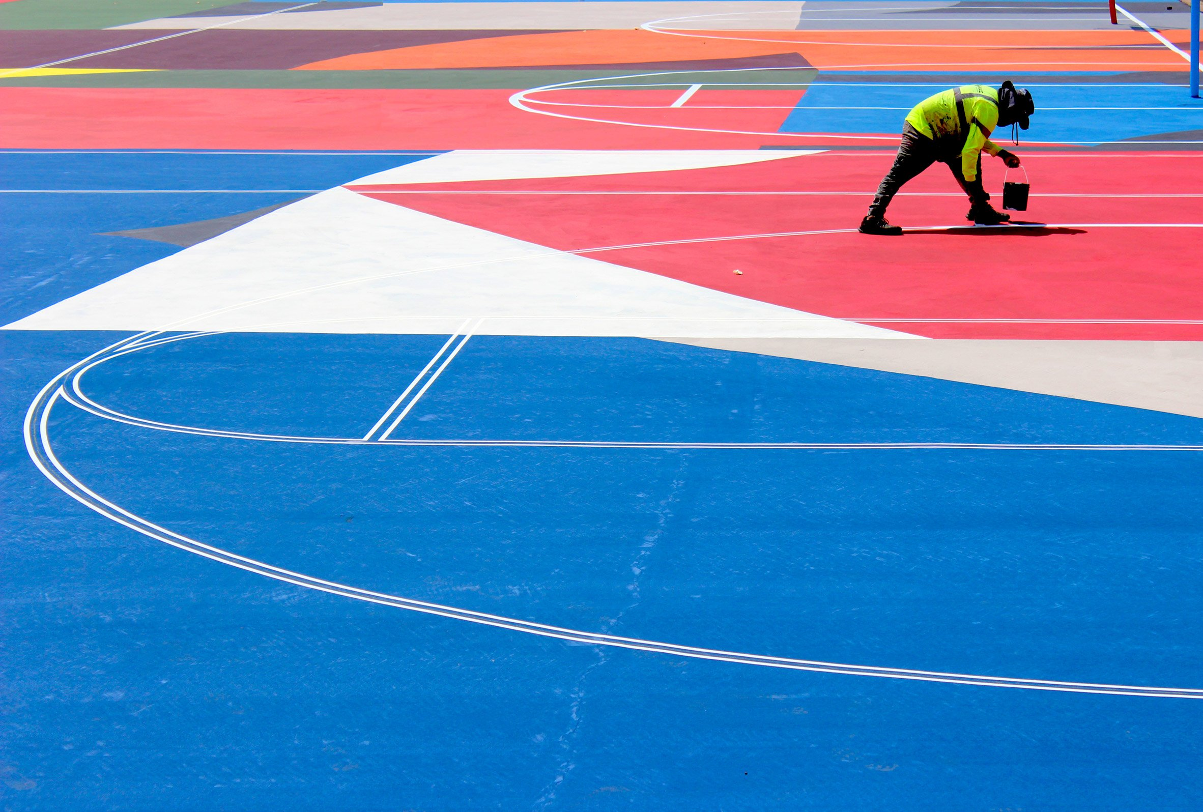 William lachance spruces up st louis basketball courts for Basketball court mural