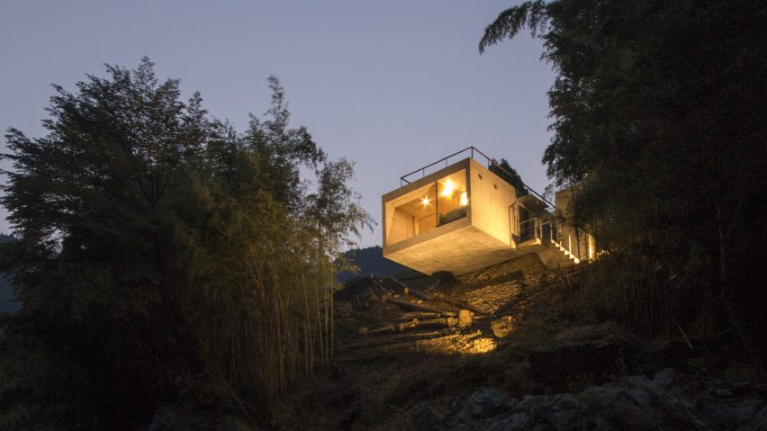 Holiday home by Masato Sekiya cantilevers over a river bank in Nara Prefecture