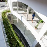 Kientruc O carves elliptical lightwell between Vietnamese house and its extension