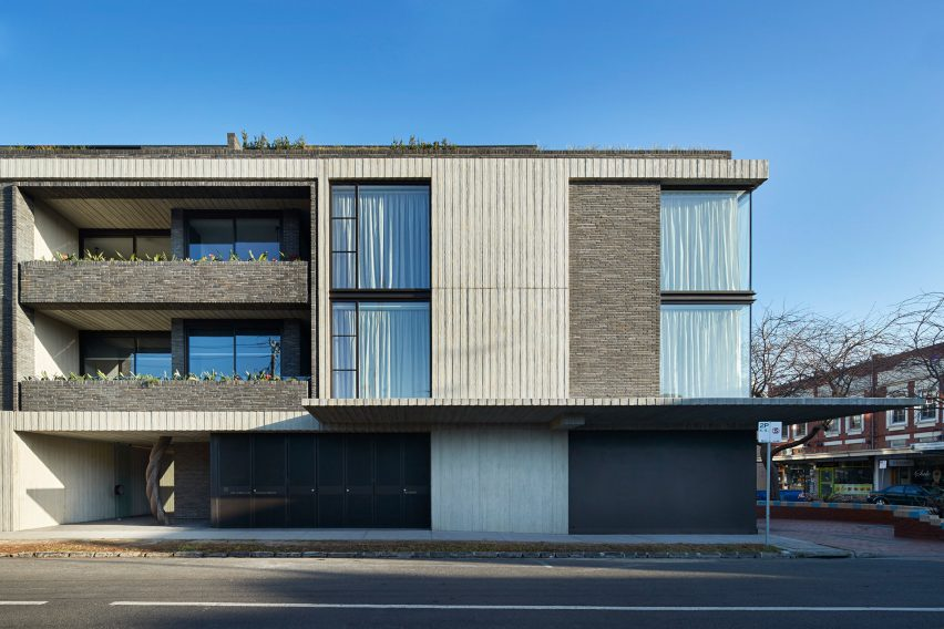 Woods bagot combines brick and board marked concrete for Apartment complex designs