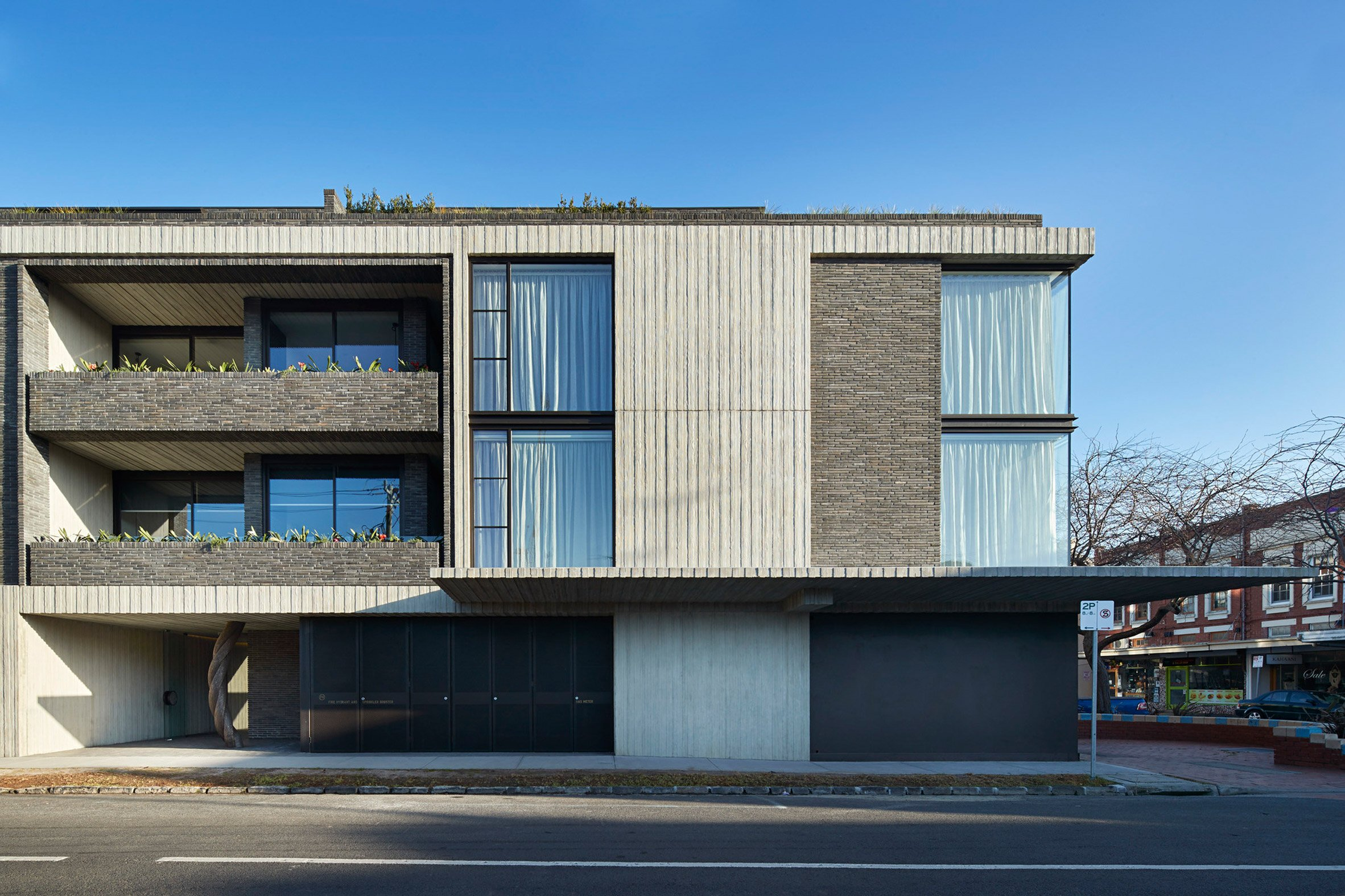 Woods Bagot combines brick and board-marked concrete throughout Elwood House apartments
