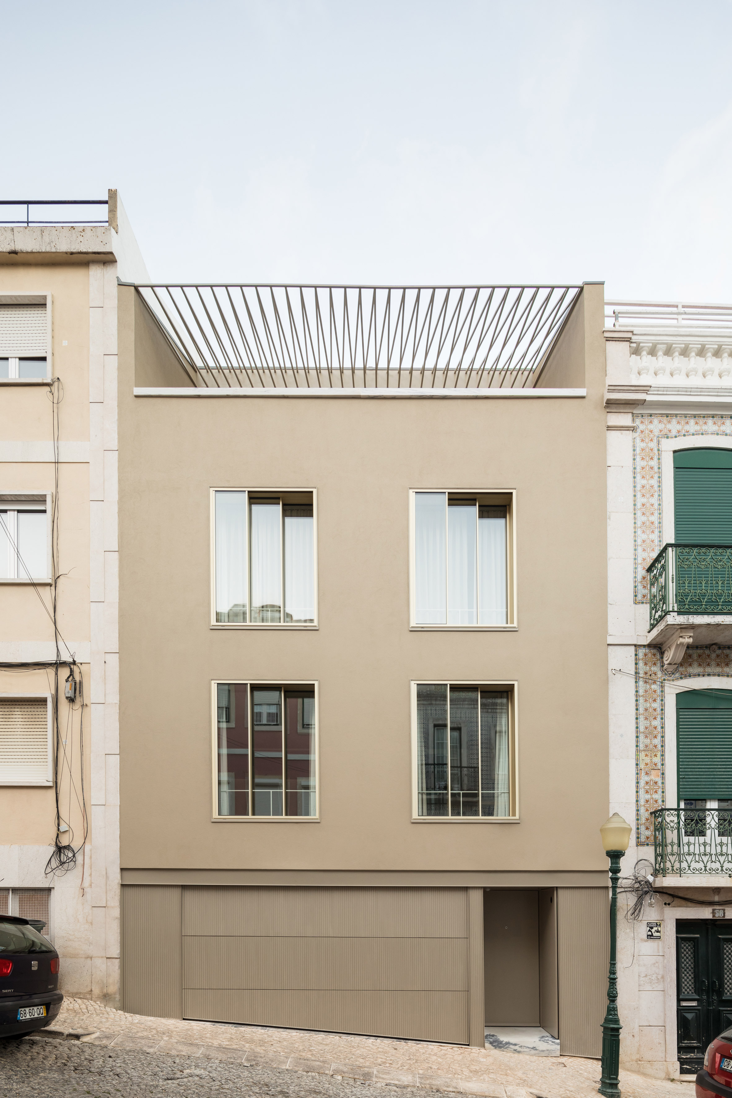 Bak Gordon converts traditional Lisbon house into apartments with private courtyard