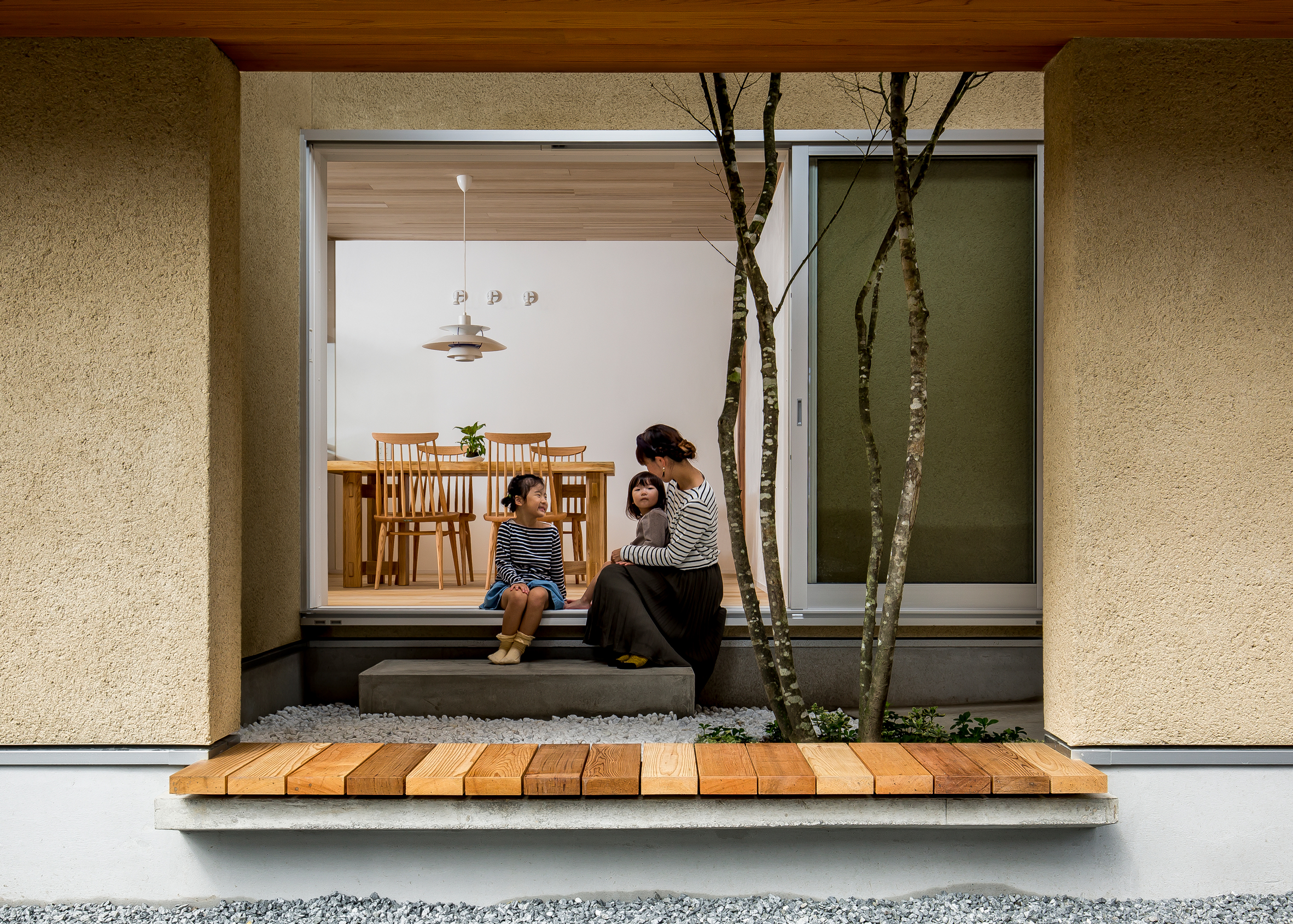 Hearth Architects completes family house in Shiga with tree-planted atrium