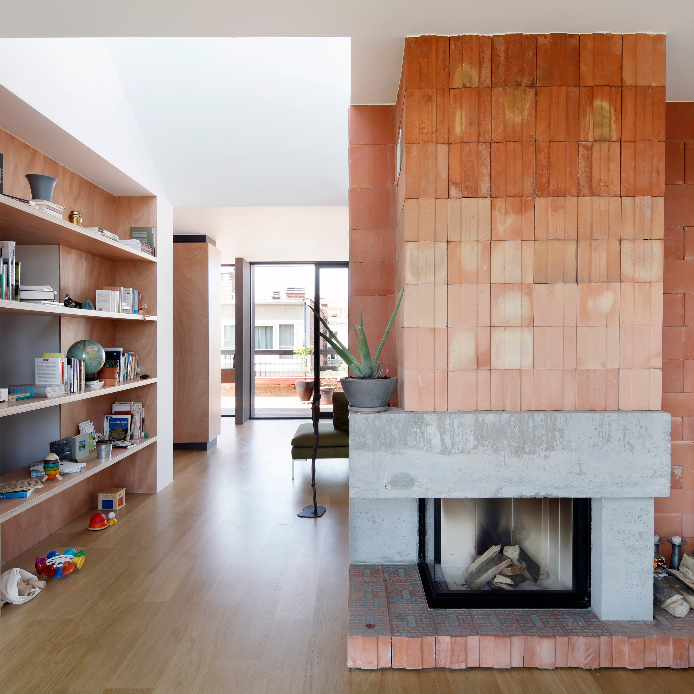 alvar aalto inspired the orange fireplace in this brussels roof