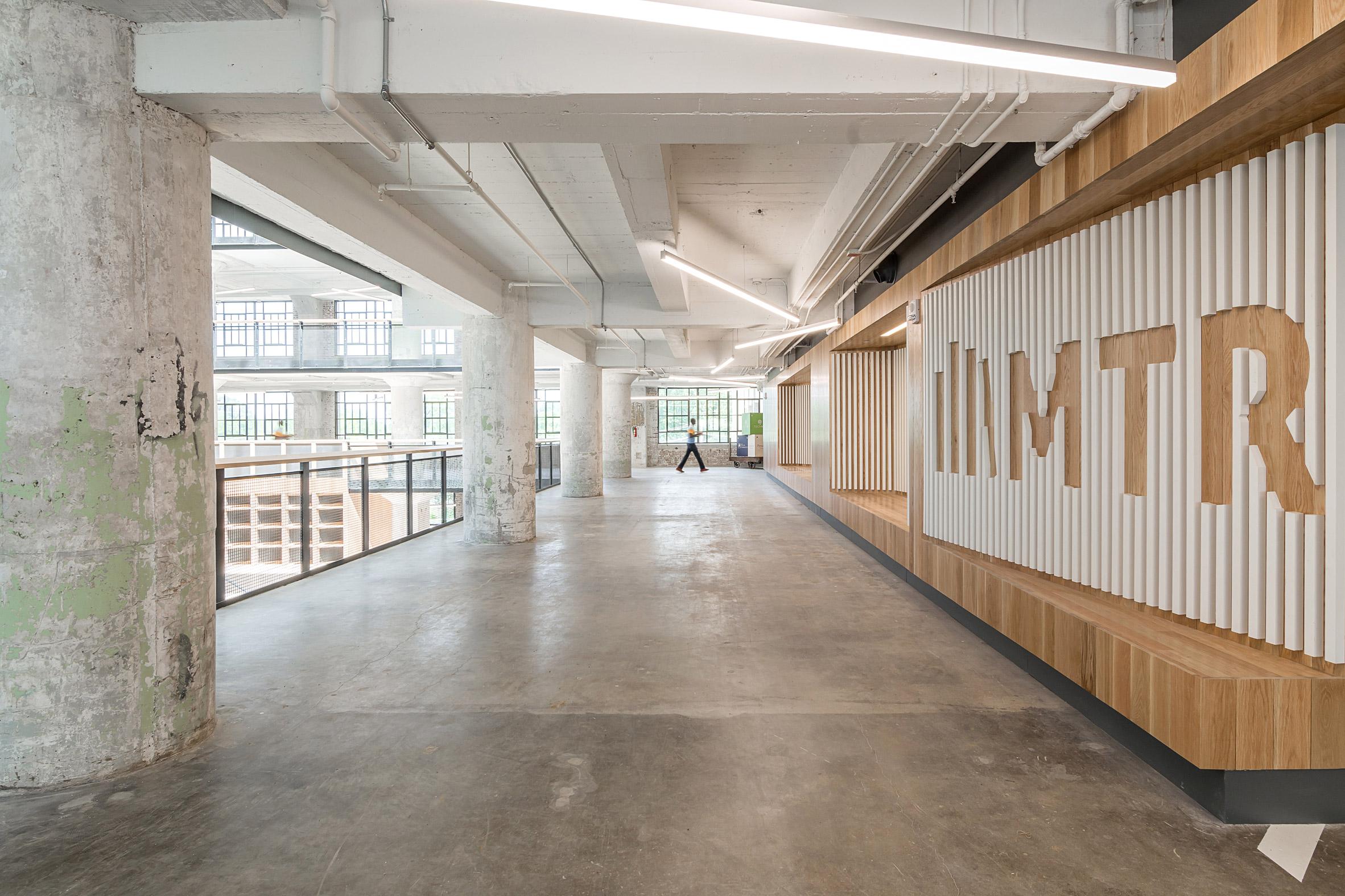 Archimania transforms part of historic Memphis warehouse into teacher training centre