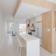 Plywood staircase extends up through centre of Philadelphia townhouse by ISA