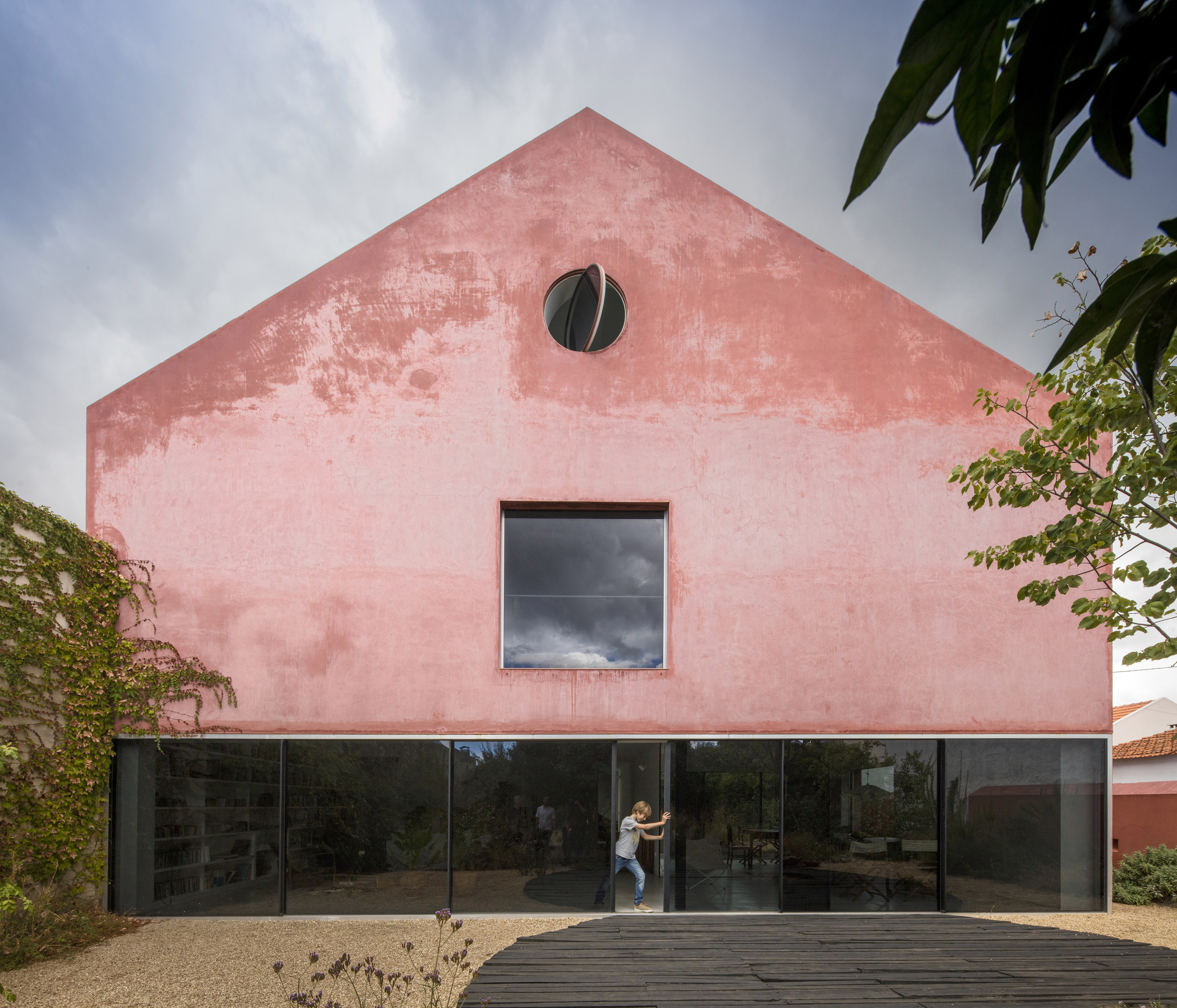 Extrastudio transforms Portuguese winery into house covered with rough red mortar