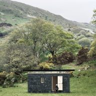 Slate-covered writer's retreat by TRIAS sits in a Welsh valley