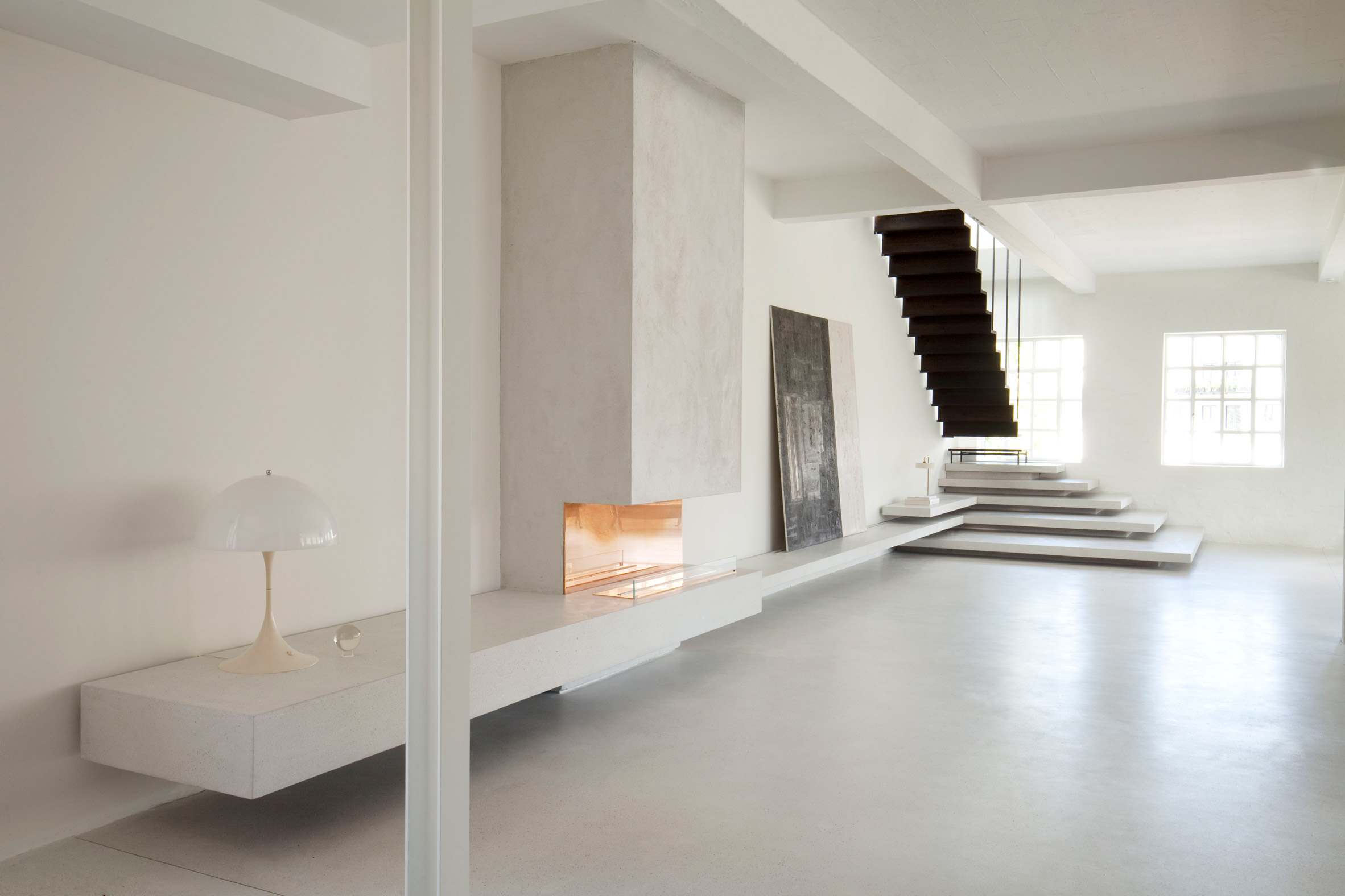 Smoked oak and terrazzo steps feature in renovated Copenhagen apartment