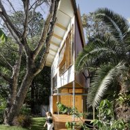 Extremely pointed garden room features a treehouse-like design and a climbing wall