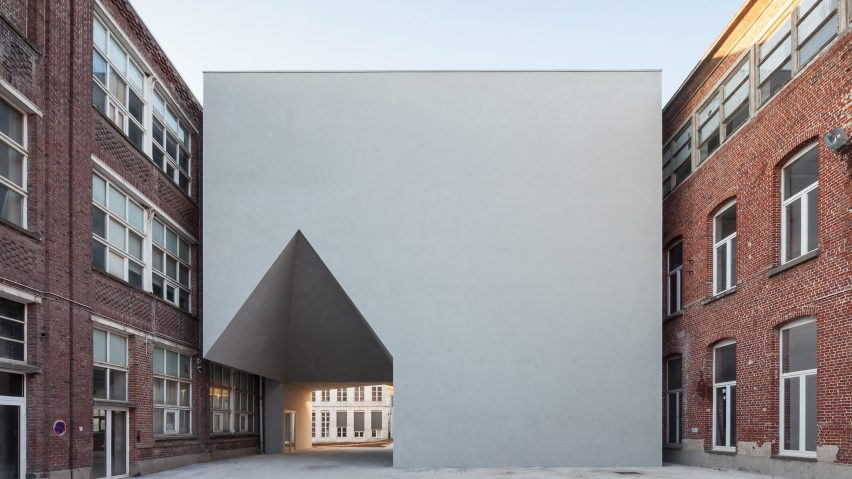 House-shaped opening cuts through Belgian school of architecture by Aires Mateus