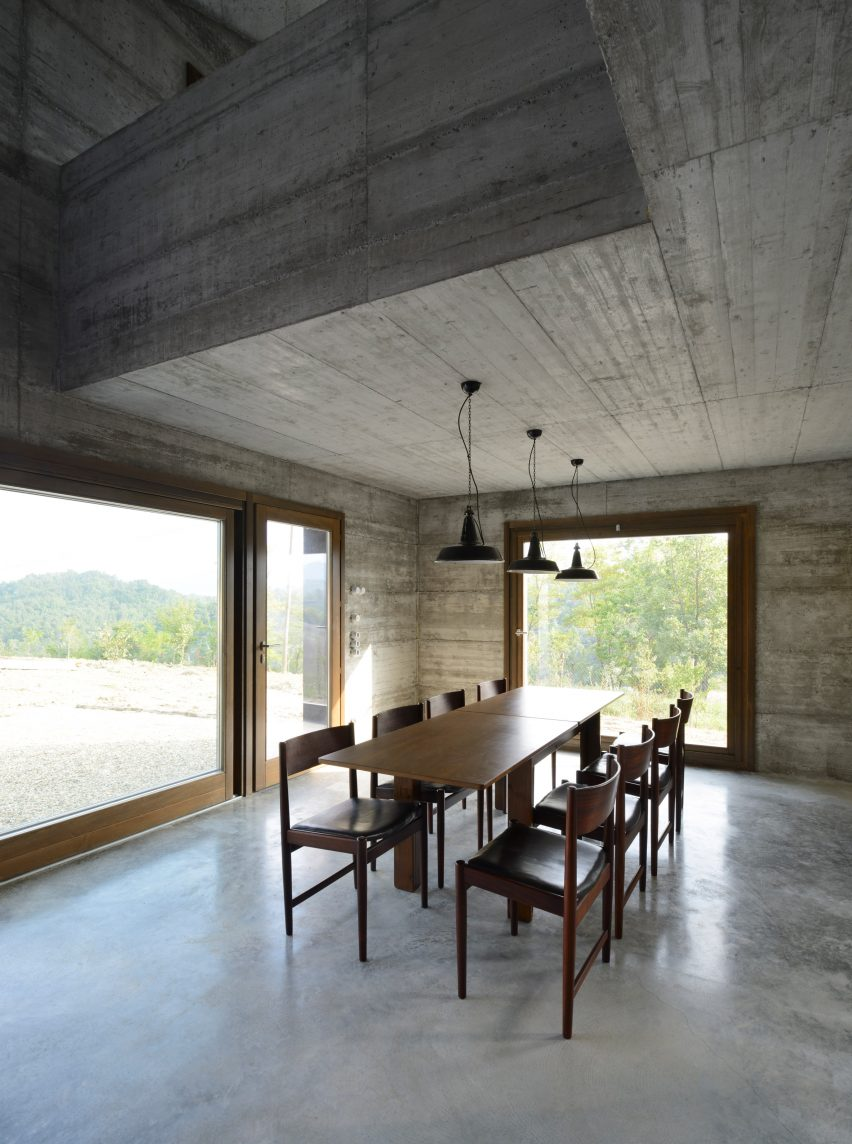 House R by 35a Studio is a concrete holiday home with a twisted roof