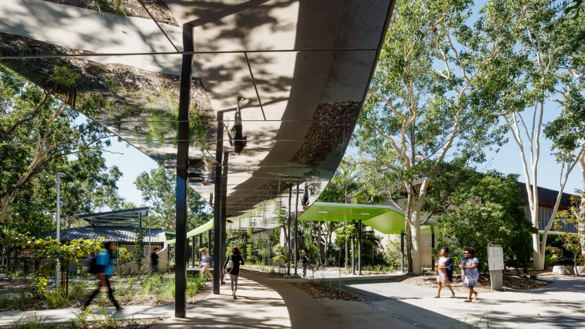 mirrored ceilings reflect surroundings of walkway at australian
