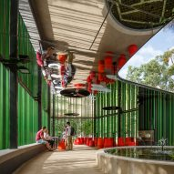 Mirrored ceilings reflect surroundings along walkway installed at Australian university campus
