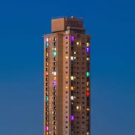 Residents of Sydney high-rise estate use lights to protest against gentrification