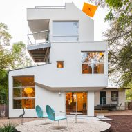 Tom Hurt attaches tiered white pods with plywood core to Austin house