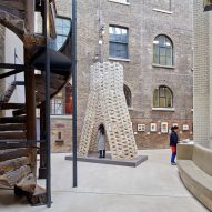 AAU Anastas stacks robotically cut stone blocks into tower at V&A