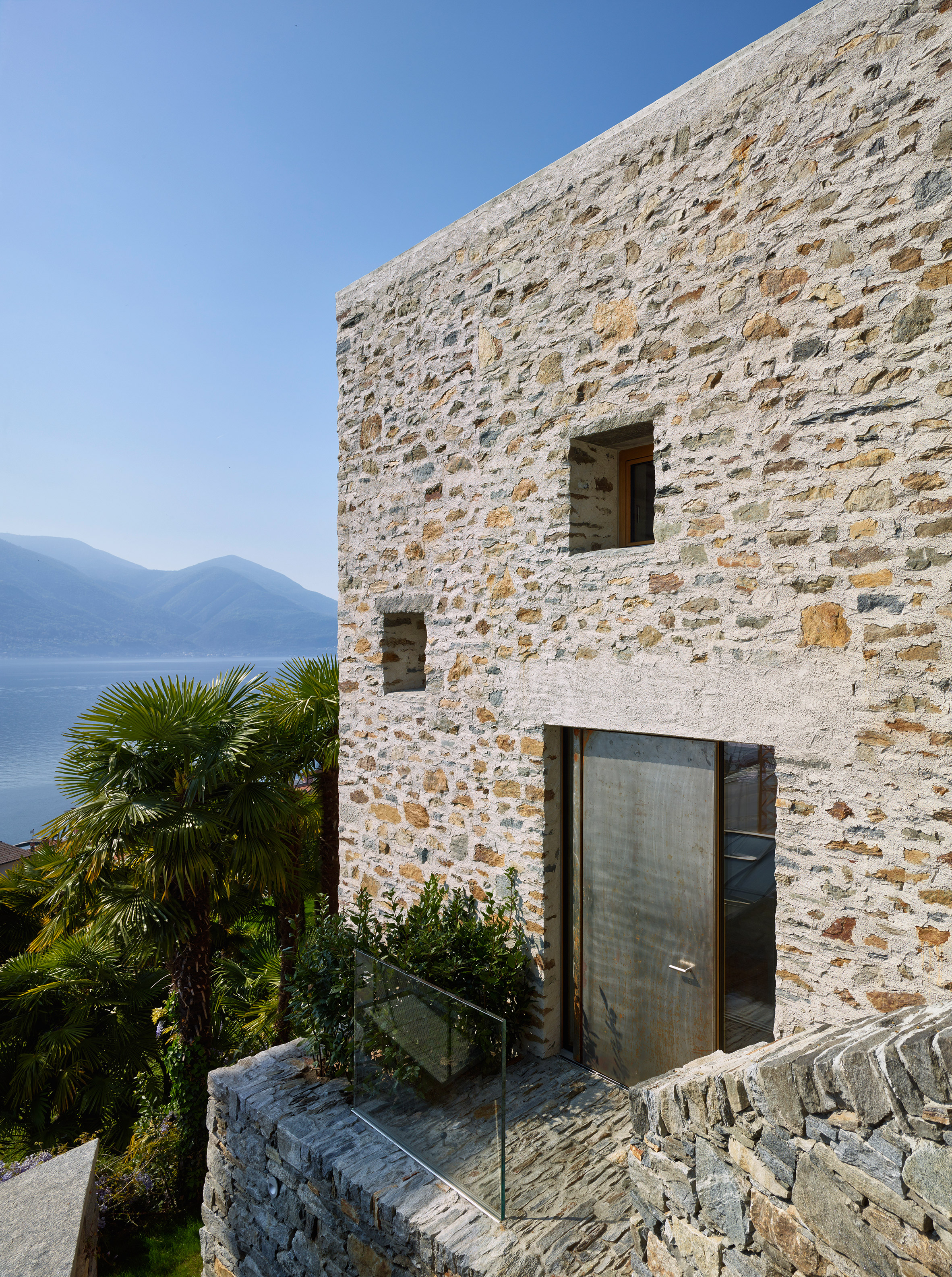 Wespi de Meuron Romeo Architetti uses local stone and plaster for lakeside house
