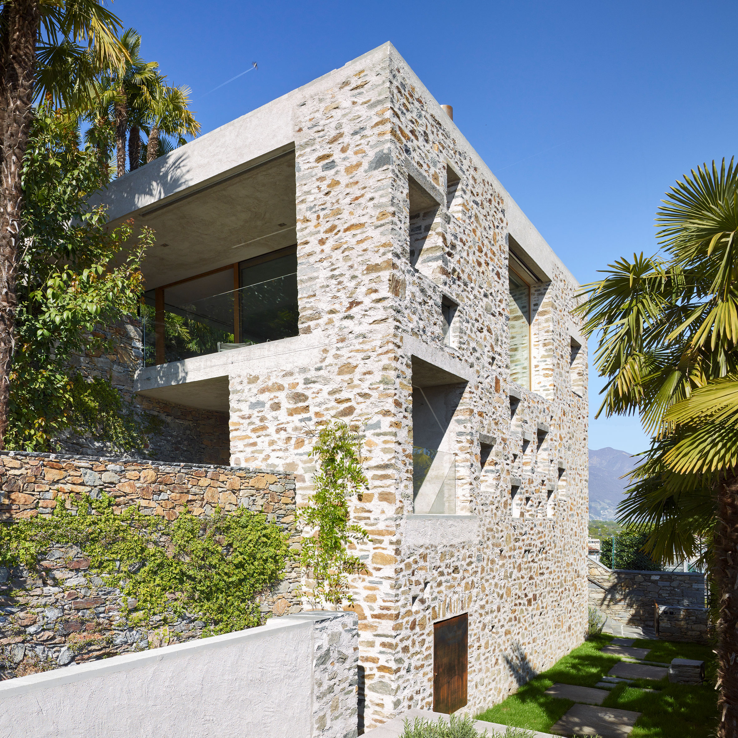 Wespi de meuron romeo architetti uses local stone and plaster for lakeside house in switzerland