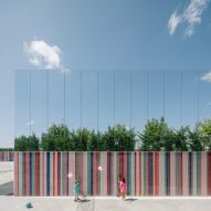 Mirrored panels and stripy tiles cover walls of Spanish school by ABLM Arquitectos