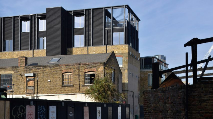 Simon Conder Associates has placed an extension clad in black-stained timber on top of a former warehouse in east London.