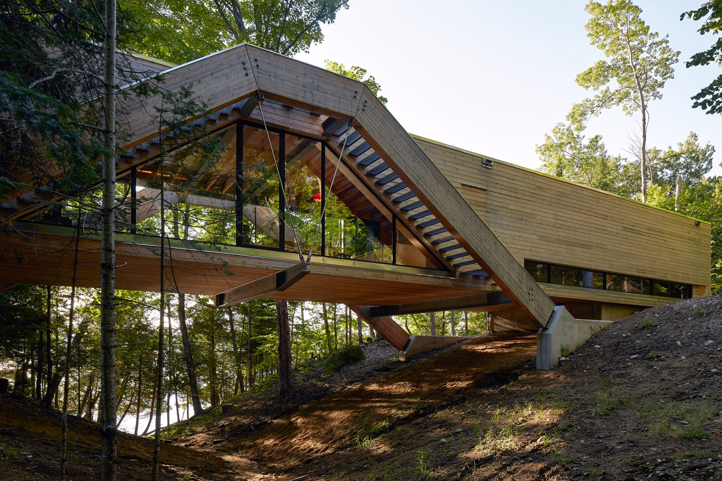 Bridgehouse by Llama Urban Design spans over Canadian forest floor