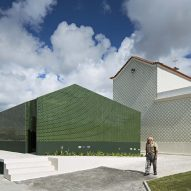 Deep-green tiles and geometric entrances create distinctive toilets for Portuguese graveyard