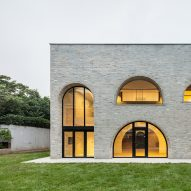Arched openings punctuate brick-clad house in Seoul by Tectonics Lab