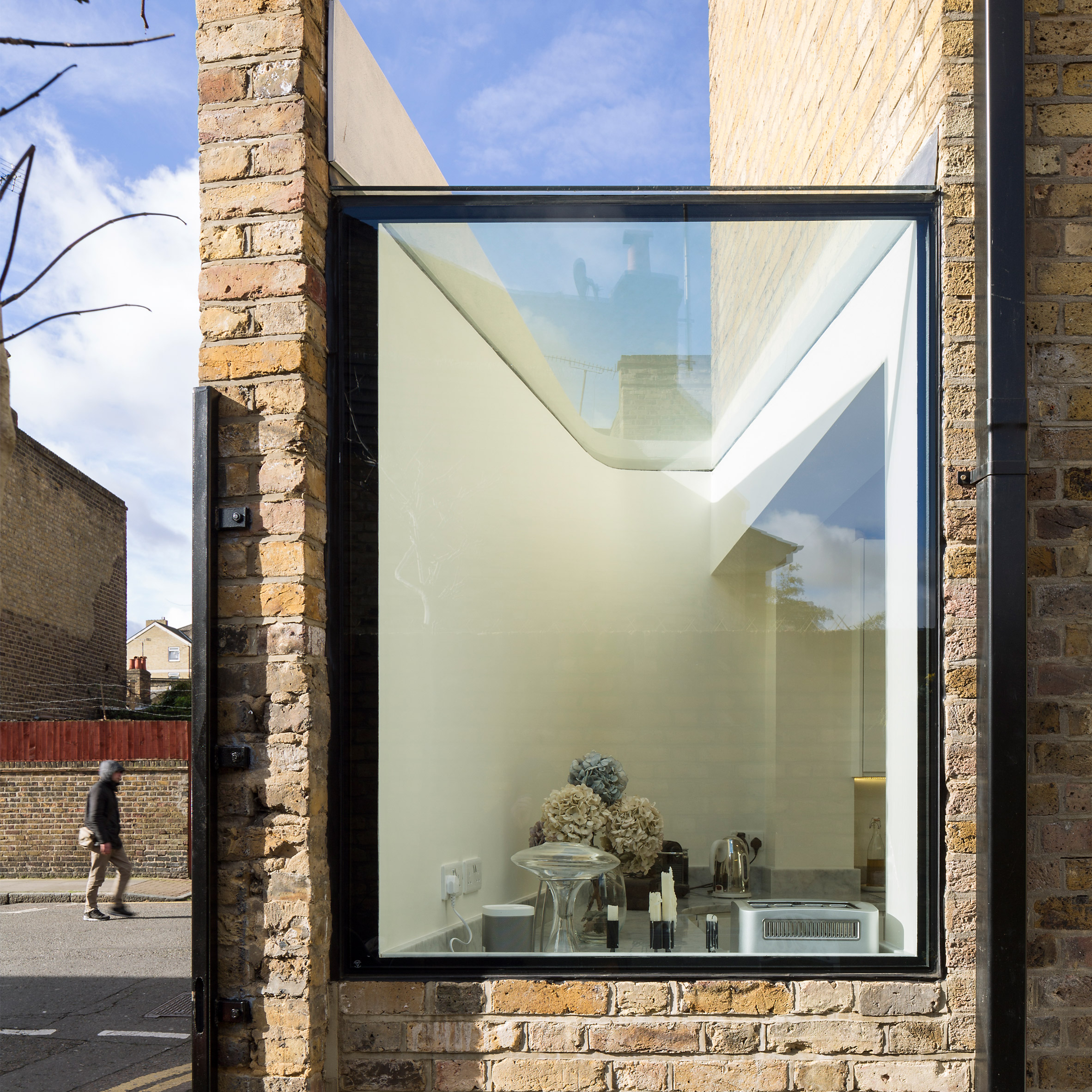Giant pivoting door connects Columbia Road extension to secluded rear  courtyard