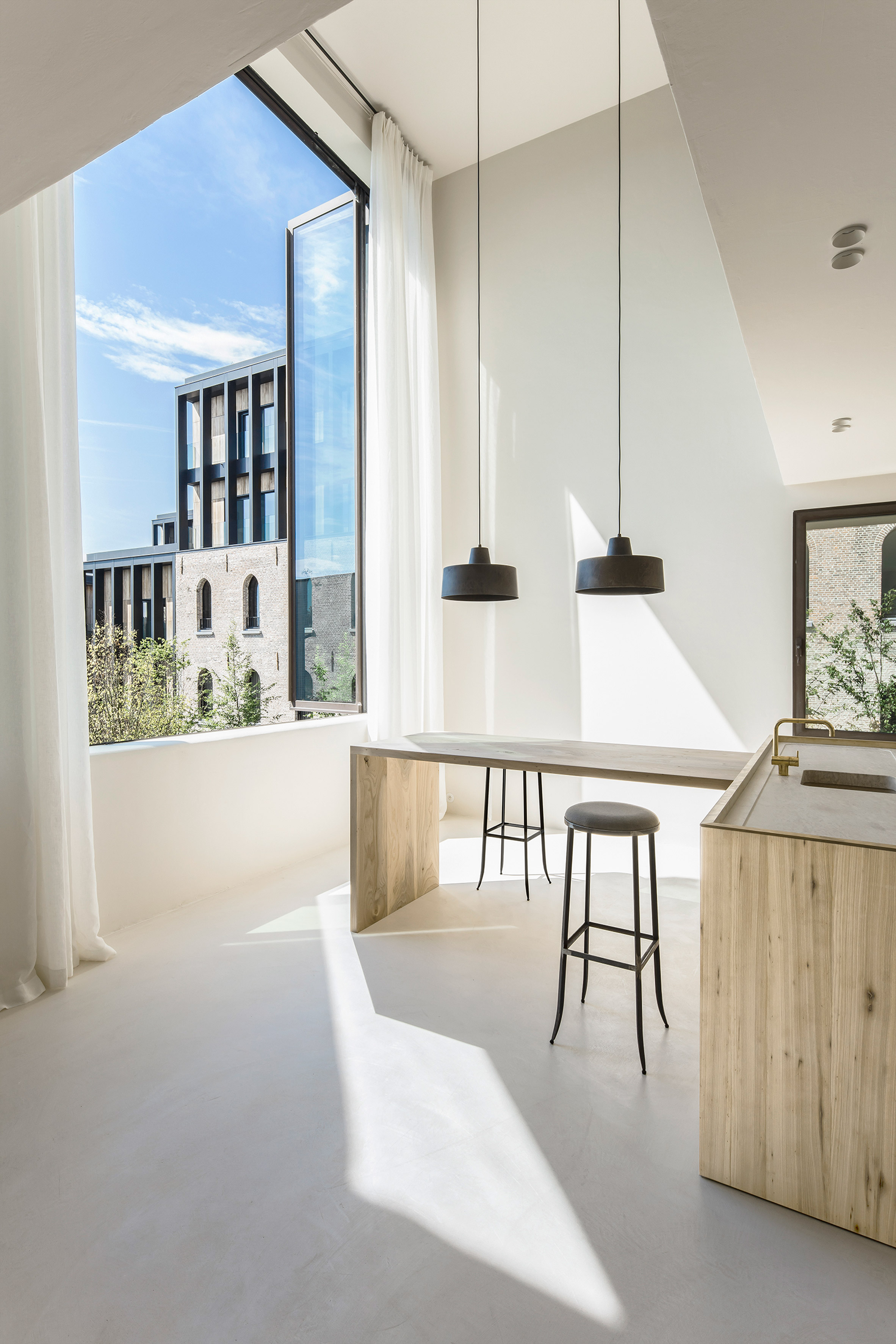 """Arjaan De Feyter combines """"light and warm materials"""" in converted ..."""