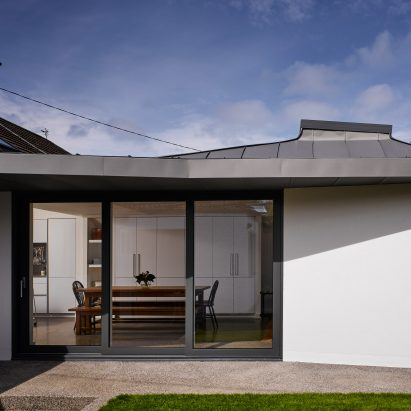 Zinc-clad vaulted roof tops extension to coastal house in Dublin by Arigho Larmour Wheeler