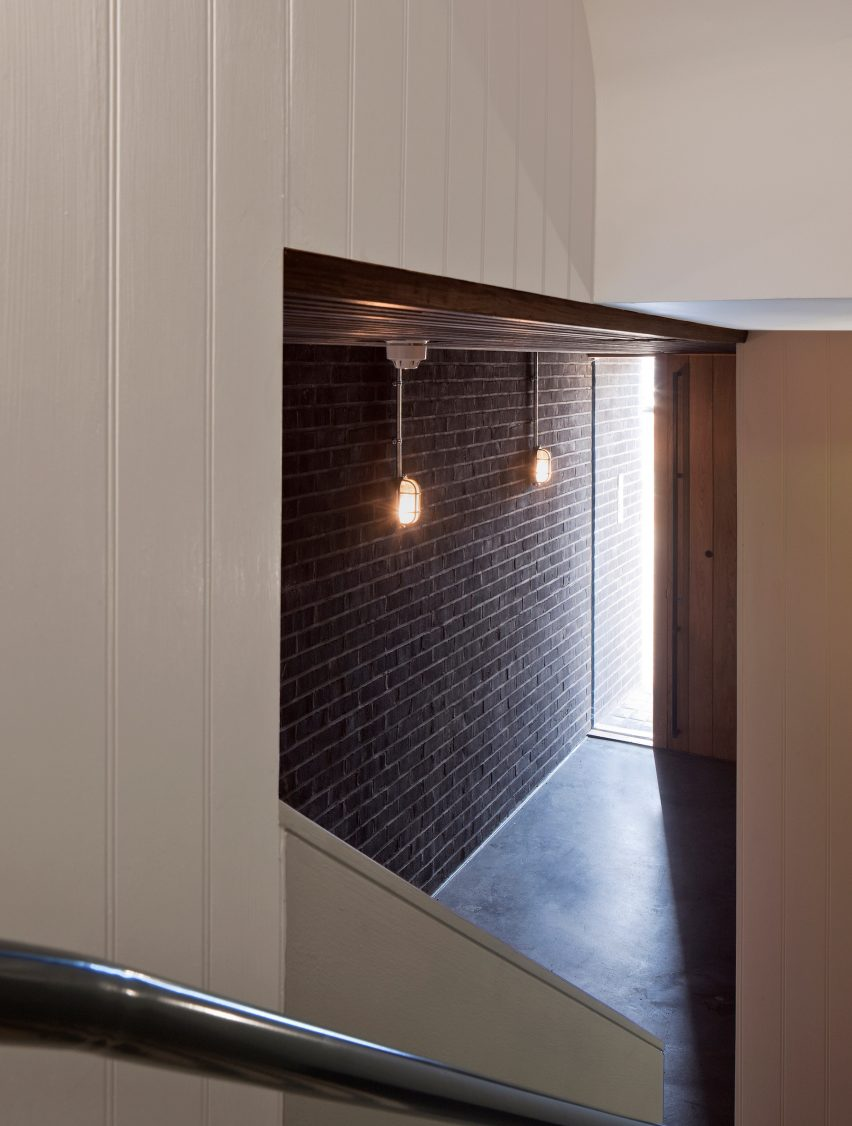 denizen works pairs black bricks with pointy panels for whitstable