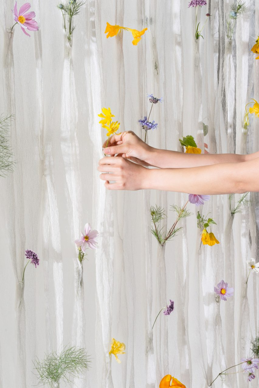 Fresh blooms decorate Draped Flowers Curtain woven from paper