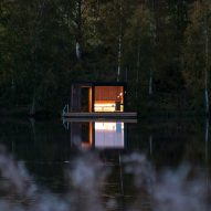 Small Architecture Workshop's charred-timber sauna floats on a Swedish lake