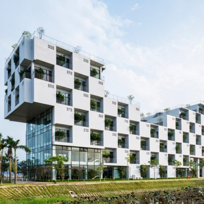 vo trong nghia incorporates trees into chequerboard facade of hanoi university building