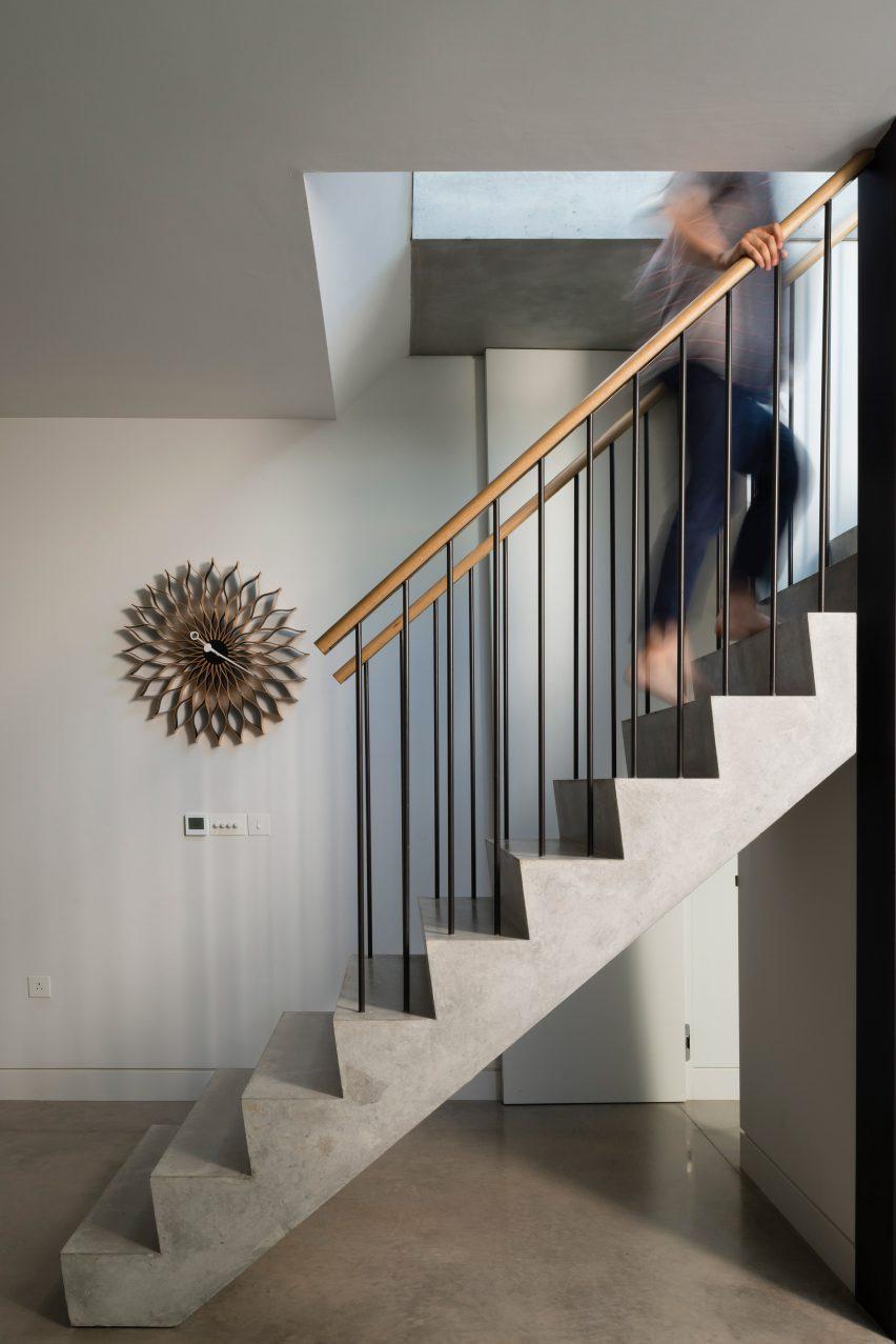 Pre cast concrete staircase forms centrepiece of basement for Basement forms