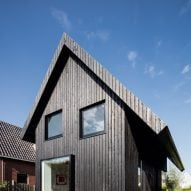 Dutch architect Chris Collaris has completed a house in Amsterdam clad entirely in blackened timber and featuring an asymmetric gabled roof.