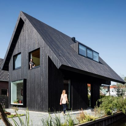 Chris Collaris Architects completes black wooden cottage with exaggerated roof & Architecture with gables | Dezeen memphite.com