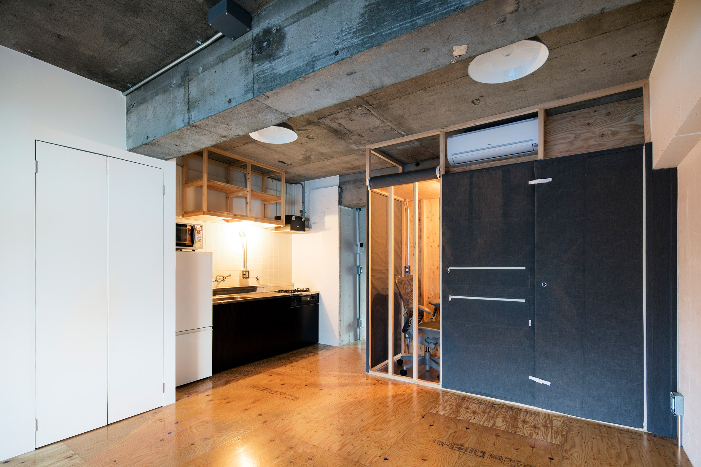 Renovated apartment in Tokyo has storage pockets sewn into its walls