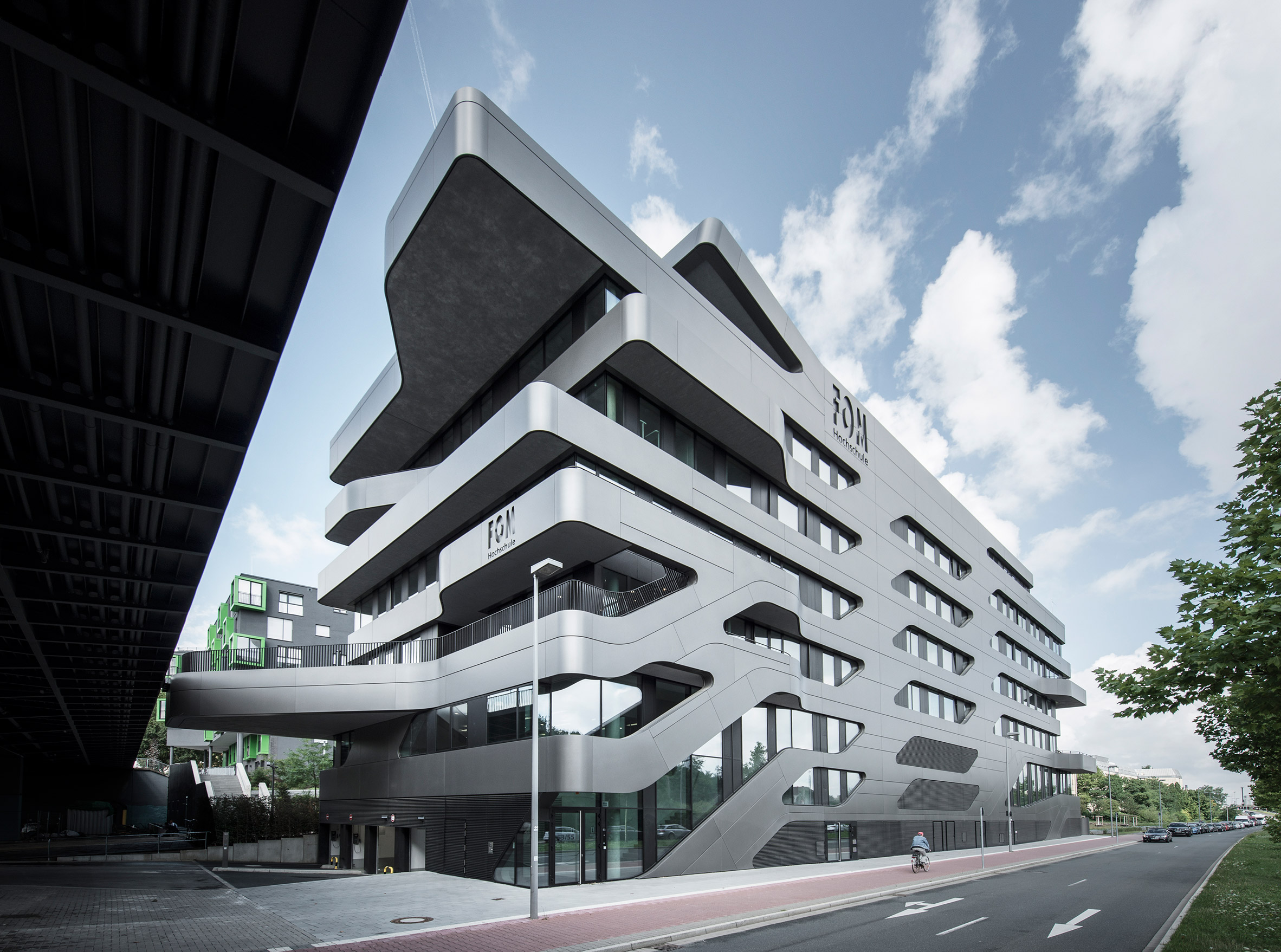 Jürgen Mayer H's FOM Hochschule building features bulging balconies and seamless stairs