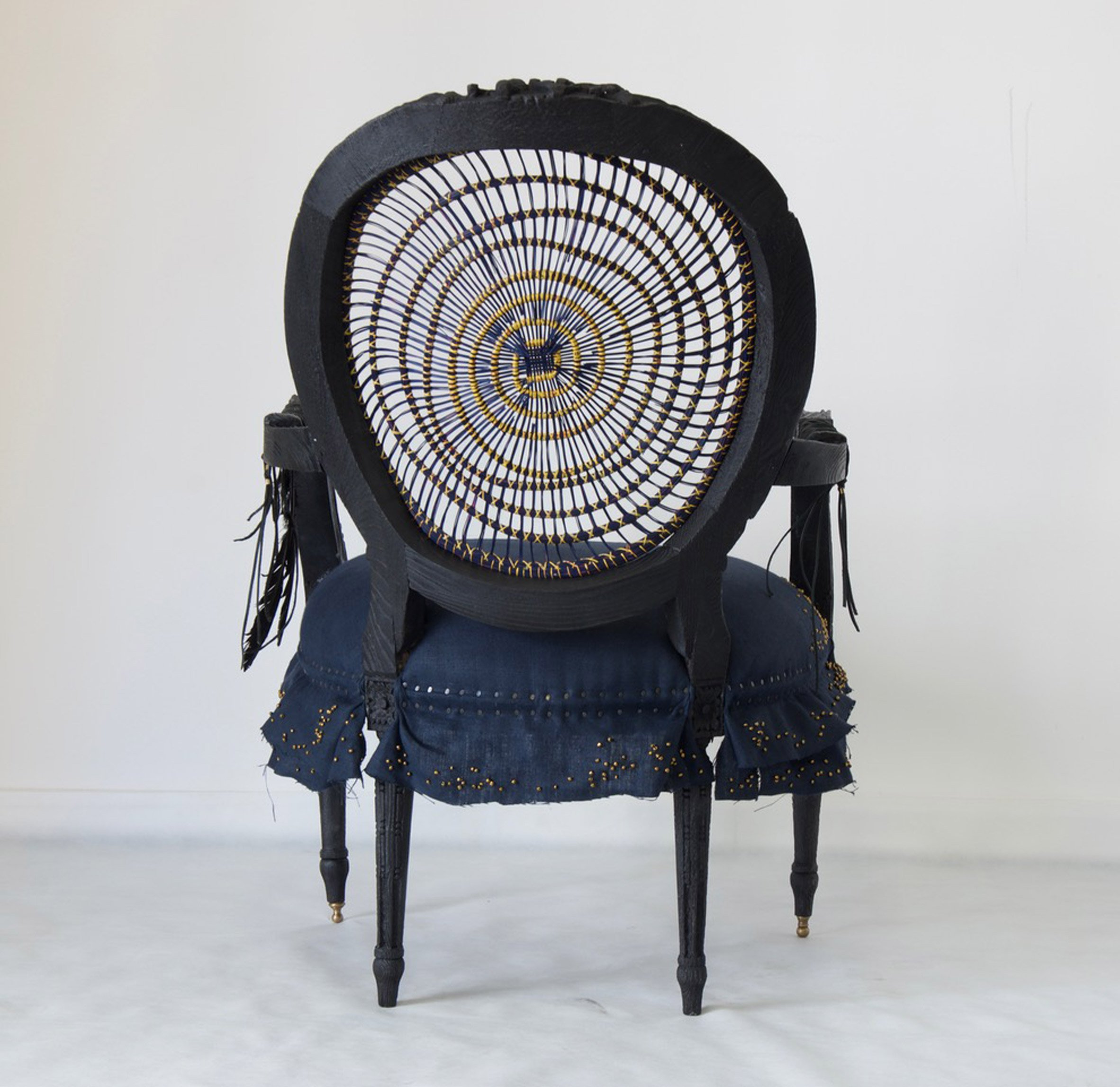Atang Tshikare and Eve Collett's Leifo chair combines scorched timber and woven grass