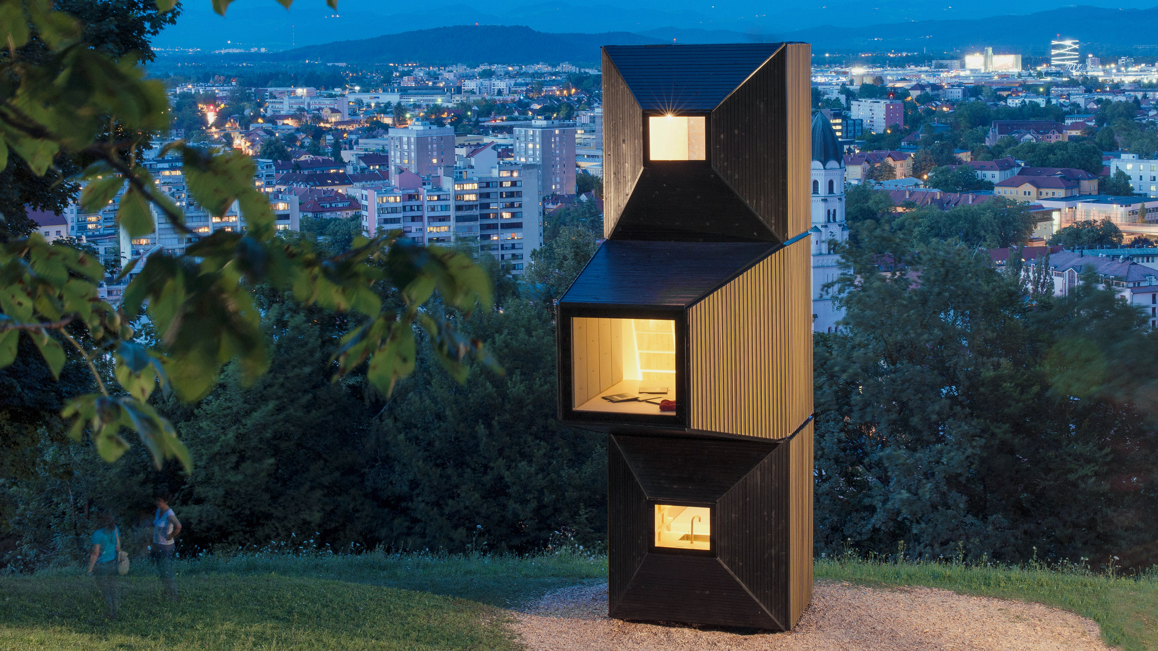 OFIS Arhitekti Uses Modular Living Units To Create Pop Up Library  Overlooking Ljubljana