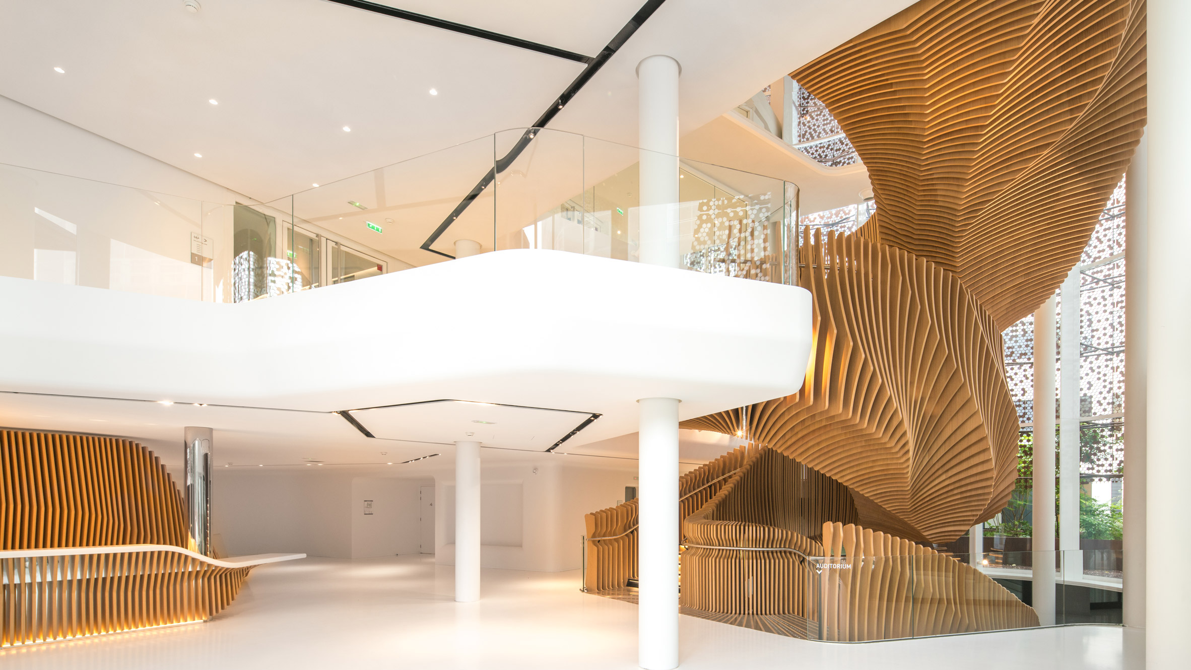 ora to uses hundreds of wooden slats for snaking oak stair at lvmh offices