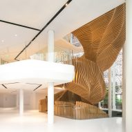 Ora Ïto uses hundreds of wooden slats for snaking oak stair at LVMH offices