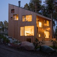 Ortraum Architects builds forest home in Finland with a trapeze, a climbing wall and a hammock
