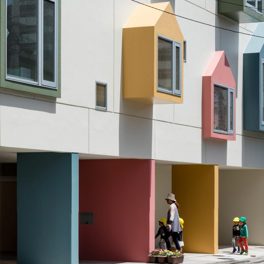 Colourful house shaped boxes surround windows at nursery for Architect education